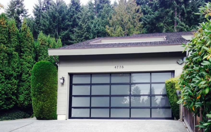 Beautiful Glass Garage Door By Clopay With Frosted Glass And A Black  Anodized Frame. Compliment