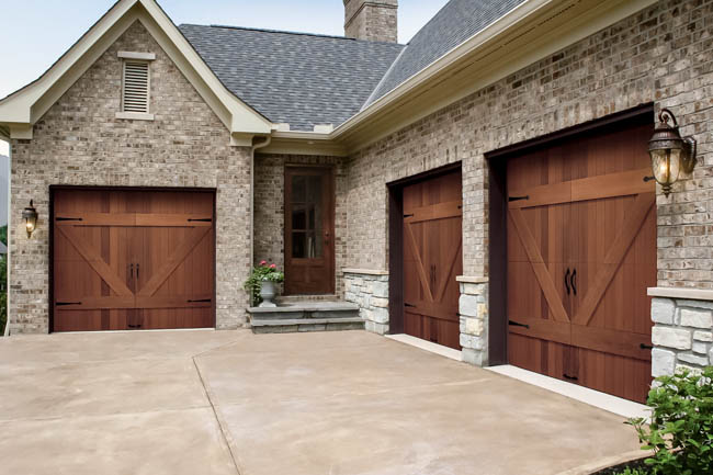 Carriage style insulated garage doors clopay reserve wood for Wood look garage doors